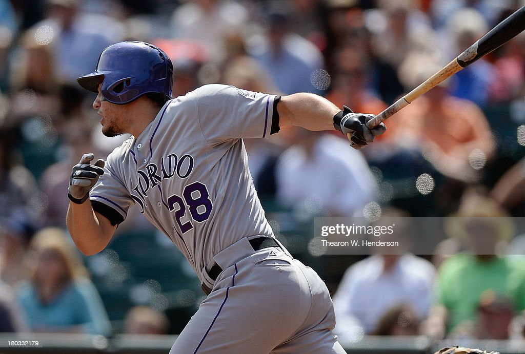 <a gi-track='captionPersonalityLinkClicked' href=/galleries/search?phrase=Nolan+Arenado&family=editorial&specificpeople=7934273 ng-click='$event.stopPropagation()'>Nolan Arenado</a> #28 of the Colorado Rockies hits an RBI scoring Corey Dickerson #6 during the fourth inning against the San Francisco Giants at AT&T Park on September 11, 2013 in San Francisco, California.