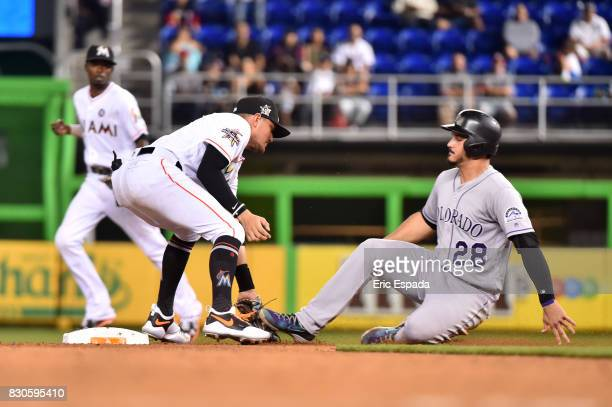 Nolan Arenado of the Colorado Rockies is caught stealing during the seventh inning against the Colorado Rockies at Marlins Park on August 11 2017 in...