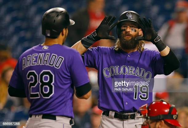 Nolan Arenado of the Colorado Rockies is congratulated by Charlie Blackmon after hitting a tworun home run in the ninth inning of a game against the...