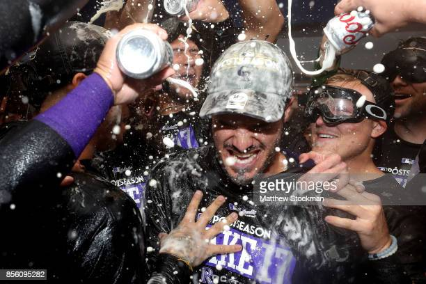 Nolan Arenado of the Colorado Rockies is doused by his teammates in the lockerroom at Coors Field on September 30 2017 in Denver Colorado Although...