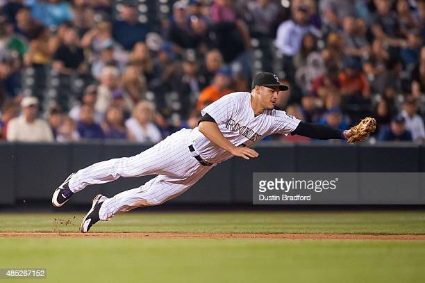 Nolan Arenado of the Colorado Rockies makes a diving defensive play against the New York Mets in the eighth inning of a game at Coors Field on August...