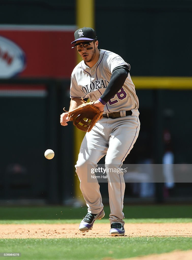 Nolan Arenado #28 of the Colorado Rockies makes a play on a bouncing ball off the bat of Yasmany Tomas of the Arizona Diamondbacks, who was thrown out at first base during the fourth inning at Chase Field on May 01, 2016 in Phoenix, Arizona. Rockies won 6-3.