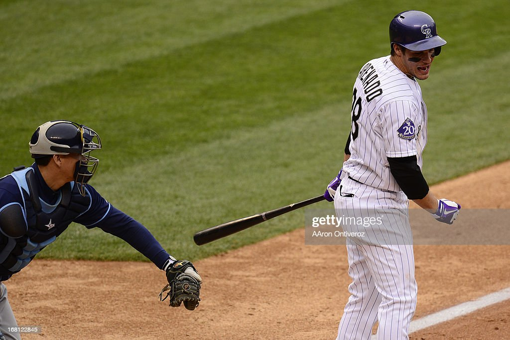 Nolan Arenado (28) of the Colorado Rockies reacts to striking out to make the final out o the game as Jeremy Hellickson (58) of the Tampa Bay Rays applies the tag during the Rockies' 8-3 loss. The Tampa Bay Rays took two of three games from the Rockies in the series.