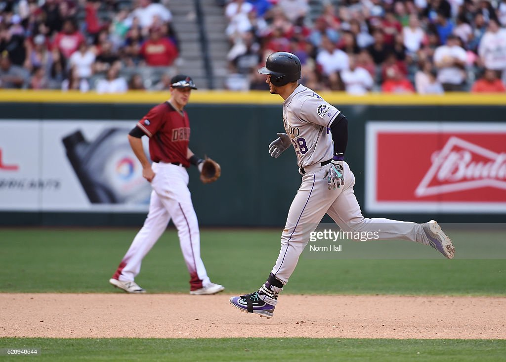 Nolan Arenado #28 of the Colorado Rockies rounds the bases after after hitting a two run home run in the seventh inning against the Arizona Diamondbacks at Chase Field on May 01, 2016 in Phoenix, Arizona.