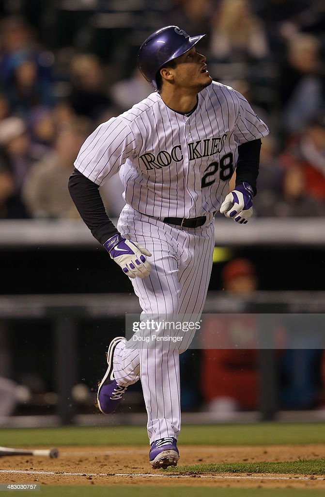 Nolan Arenado #28 of the Colorado Rockies rounds the bases on his solo home run in the sixth inning against the Arizona Diamondbacks at Coors Field on April 5, 2014 in Denver, Colorado. The Rockies defeated the Diamondbacks 9-4.
