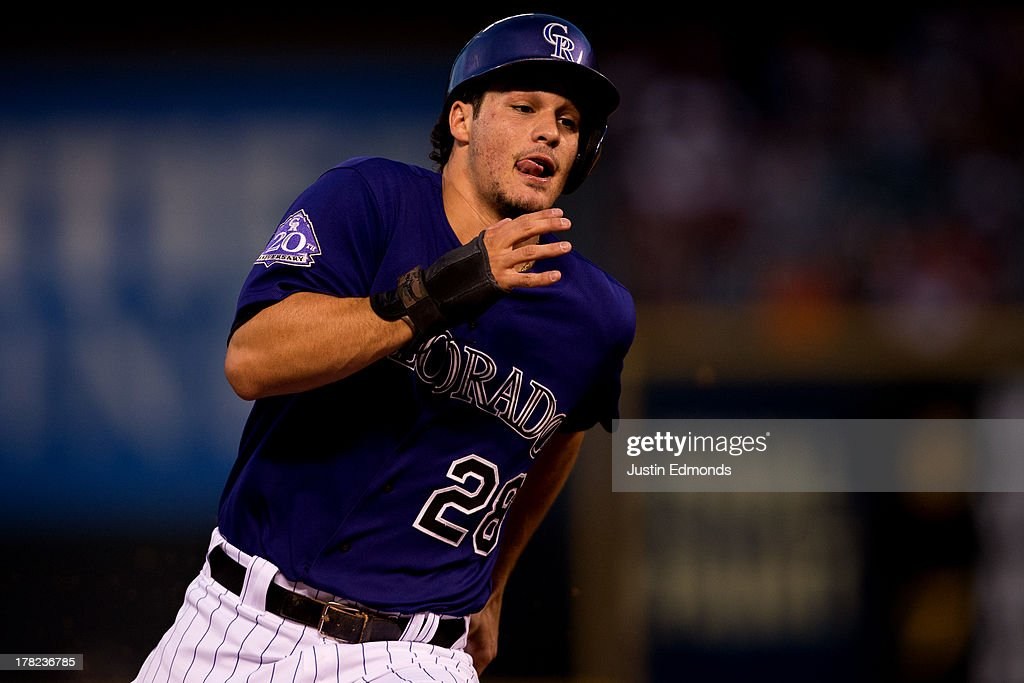 <a gi-track='captionPersonalityLinkClicked' href=/galleries/search?phrase=Nolan+Arenado&family=editorial&specificpeople=7934273 ng-click='$event.stopPropagation()'>Nolan Arenado</a> #28 of the Colorado Rockies rounds third base on his way to scoring during the third inning against the San Francisco Giants at Coors Field on August 27, 2013 in Denver, Colorado. The Giants defeated the Rockies 5-3.