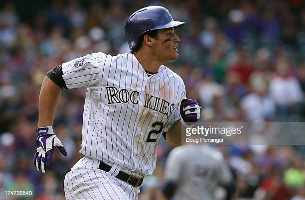 Nolan Arenado of the Colorado Rockies runs to first as he hits the game winning RBI single off of John Axford of the Milwaukee Brewers to score...