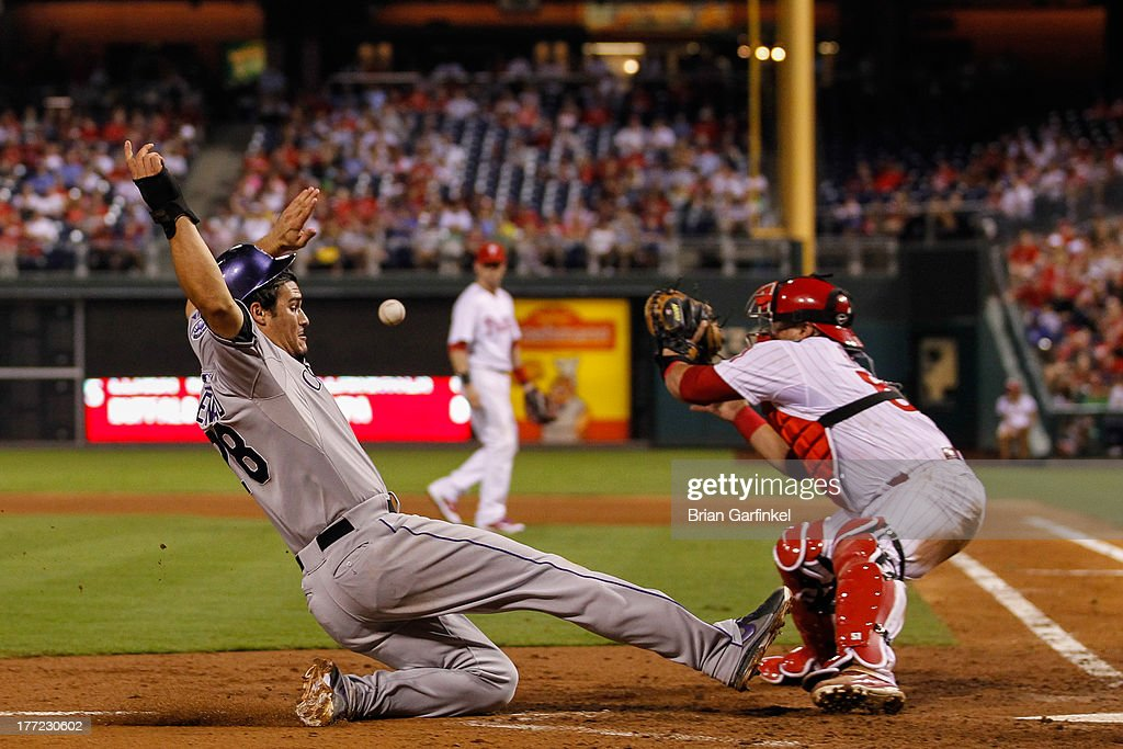 <a gi-track='captionPersonalityLinkClicked' href=/galleries/search?phrase=Nolan+Arenado&family=editorial&specificpeople=7934273 ng-click='$event.stopPropagation()'>Nolan Arenado</a> #28 of the Colorado Rockies safely slides home to score a run in the fifth inning of the game against the Philadelphia Phillies at Citizens Bank Park on August 22, 2013 in Philadelphia, Pennsylvania. The Phillies won 5-4.