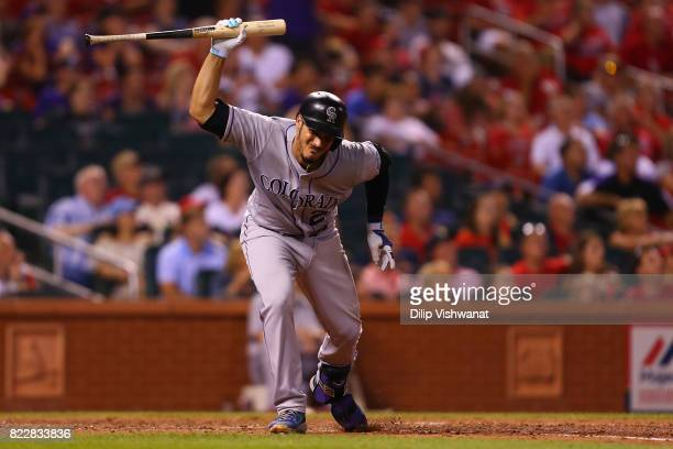 Nolan Arenado of the Colorado Rockies slams his bat down after flying out against the St Louis Cardinals in the ninth inning at Busch Stadium on July...