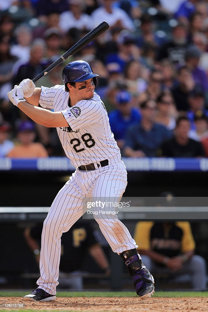 <a gi-track='captionPersonalityLinkClicked' href=/galleries/search?phrase=Nolan+Arenado&family=editorial&specificpeople=7934273 ng-click='$event.stopPropagation()'>Nolan Arenado</a> #28 of the Colorado Rockies takes an at bat against the Pittsburgh Pirates at Coors Field on August 11, 2013 in Denver, Colorado. The Rockies defeated the Pirates 3-2 and swept the three game series.