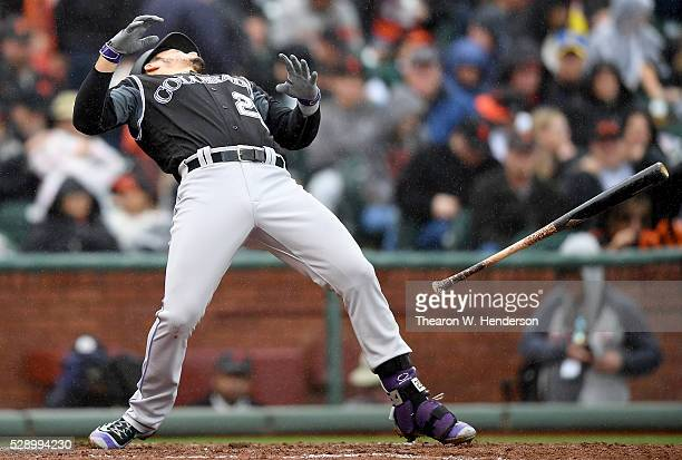 Nolan Arenado of the Colorado Rockies tosses his bat while ducking out of the way of a pitch thrown by Johnny Cueto of the San Francisco Giants in...