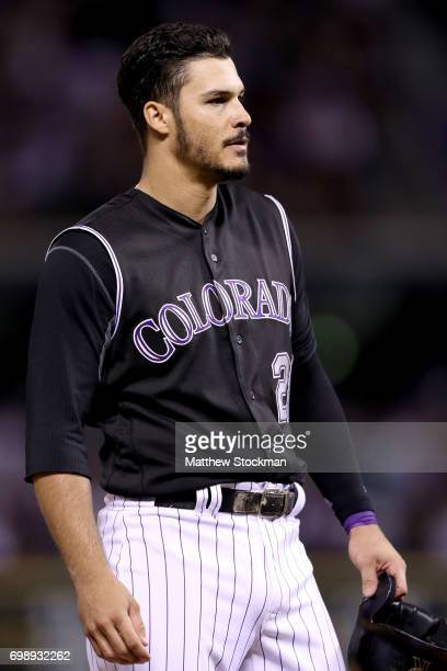 Nolan Arenado of the Colorado Rockies waits at third base for a pitching change after hitting 2 RBI triple in the eighth inning against the Arizona...