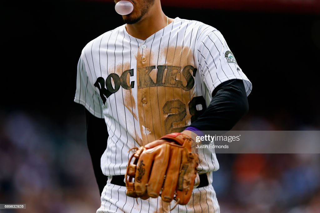Nolan Arenado #28 of the Colorado Rockies walks back to the dugout, blowing a bubble during interleague play against the Seattle Mariners at Coors Field on May 29, 2017 in Denver, Colorado. The Mariners defeated the Rockies 6-5.