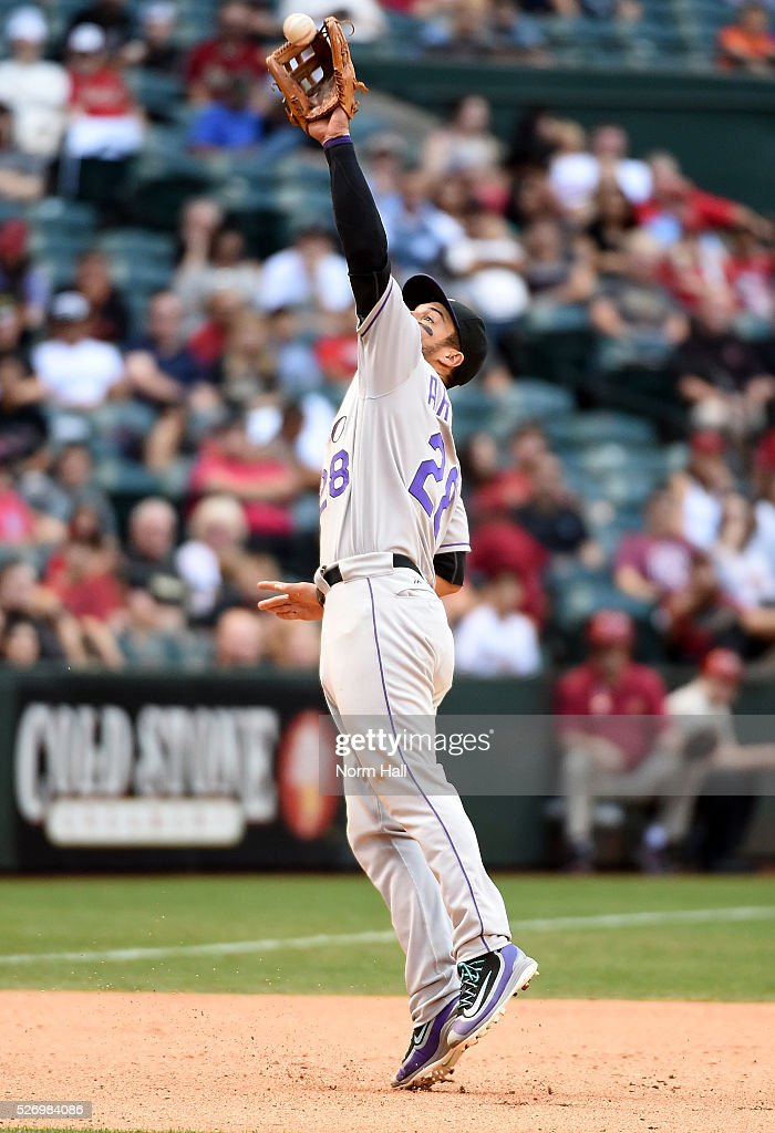 Nolan Arenado #28 of the Colorado Rockies was able to get a force out at first base after making a leaping play on a bouncing ball during the eighth inning against the Arizona Diamondbacks at Chase Field on May 01, 2016 in Phoenix, Arizona. Rockies won 6-3.