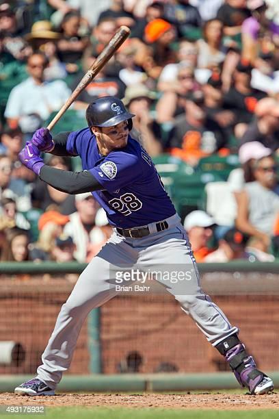 Nolan Arenado the Colorado Rockies bats against the San Francisco Giants in the sixth inning at ATT Park on October 4 2015 in San Francisco...