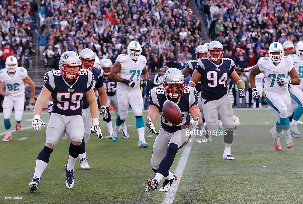 <a gi-track='captionPersonalityLinkClicked' href=/galleries/search?phrase=Nolan+Carroll&family=editorial&specificpeople=5574471 ng-click='$event.stopPropagation()'>Nolan Carroll</a> #28 of the Miami Dolphins recovers the ball after a blocked kicked against the Miami Dolphins after their game at Gillette Stadium on October 27, 2013 in Foxboro, Massachusetts.