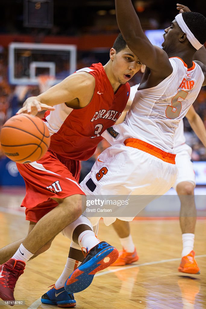 Nolan Cressler #3 of Cornell Big Red fouls <a gi-track='captionPersonalityLinkClicked' href=/galleries/search?phrase=C.J.+Fair&family=editorial&specificpeople=7366451 ng-click='$event.stopPropagation()'>C.J. Fair</a> #5 of Syracuse Orange on November 8, 2013 at the Carrier Dome in Syracuse, New York.
