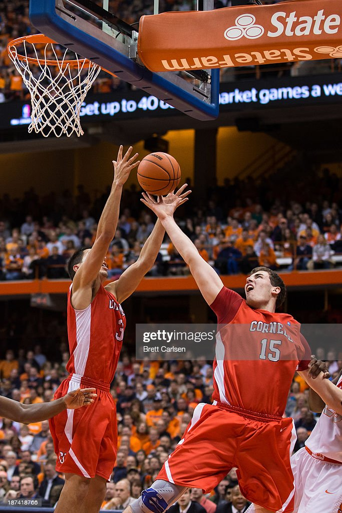 Nolan Cressler #3 of Cornell Big Red pulls down a rebound while teammate Braxston Bunce #15 reaches as well during the second half of a basketball game against Syracuse Orange on November 8, 2013 at the Carrier Dome in Syracuse, New York.