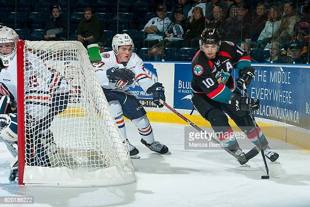 Nolan Kneen of the Kamloops Blazers stick checks Nick Merkley of the Kelowna Rockets as he skates behind the net with the puck during third period on...