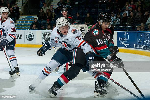 Nolan Kneen of the Kamloops Blazers stick checks Nick Merkley of the Kelowna Rockets as he skates with the puck during third period on November 1...