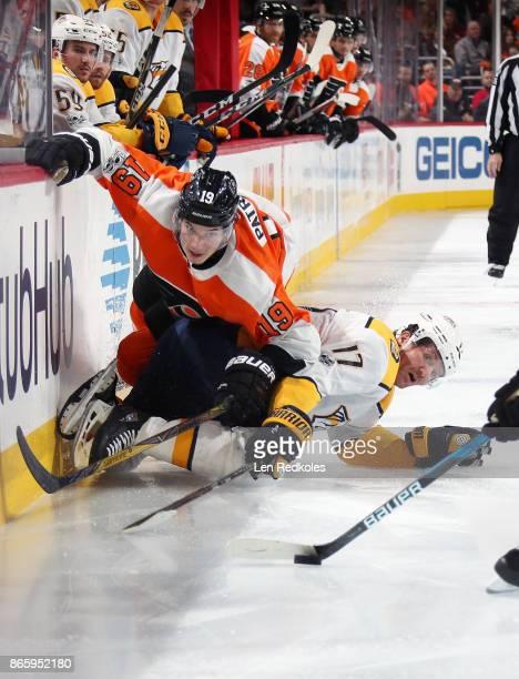 Nolan Patrick of the Philadelphia Flyers battles for the puck against Scott Hartnell of the Nashville Predators on October 19 2017 at the Wells Fargo...