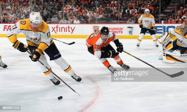 Nolan Patrick of the Philadelphia Flyers pursues the puck carried by Scott Hartnell of the Nashville Predators on October 19 2017 at the Wells Fargo...