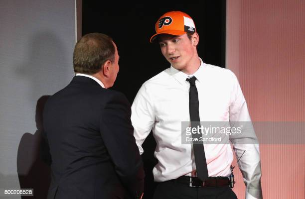 Nolan Patrick second overall pick of the Philadelphia Flyers shakes the hand of NHL Commissioner Gary Bettman onstage during Round One of the 2017...