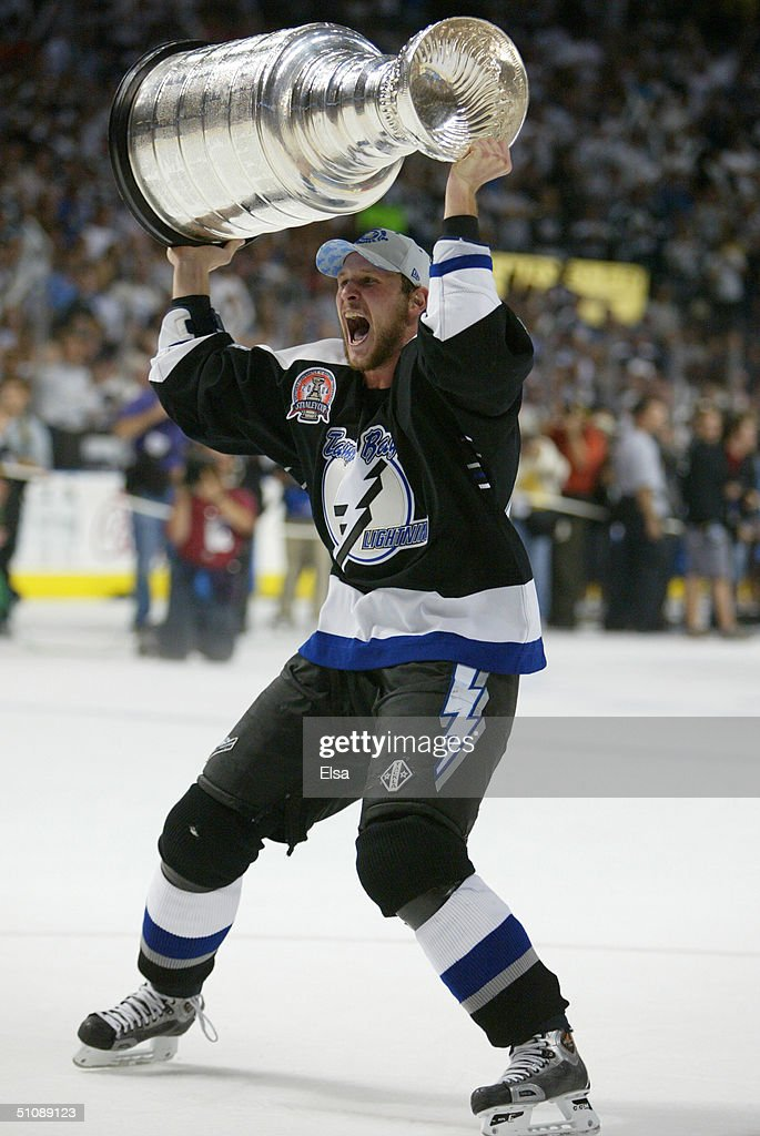 Nolan Pratt #44 of the Tampa Bay Lightning skates with the Stanley Cup above his head after the victory over the Calgary Flames in Game seven of the NHL Stanley Cup Finals on June 7, 2004 at the St. Pete Times Forum in Tampa, Florida. The Lightning defeated the Flames 2-1.