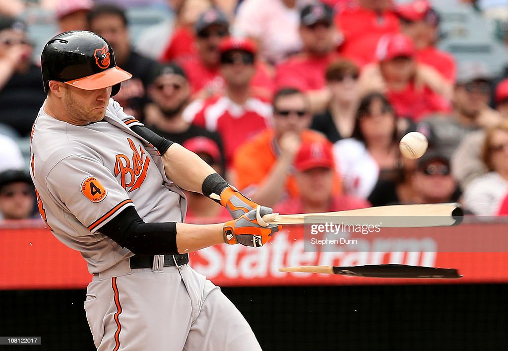 <a gi-track='captionPersonalityLinkClicked' href=/galleries/search?phrase=Nolan+Reimold&family=editorial&specificpeople=757348 ng-click='$event.stopPropagation()'>Nolan Reimold</a> #14 of the Baltimore Orioles breaks his bat as he lines out to end the Orioles' eighth inning against the Los Angeles Angels of Anaheim at Angel Stadium of Anaheim on May 5, 2013 in Anaheim, California.