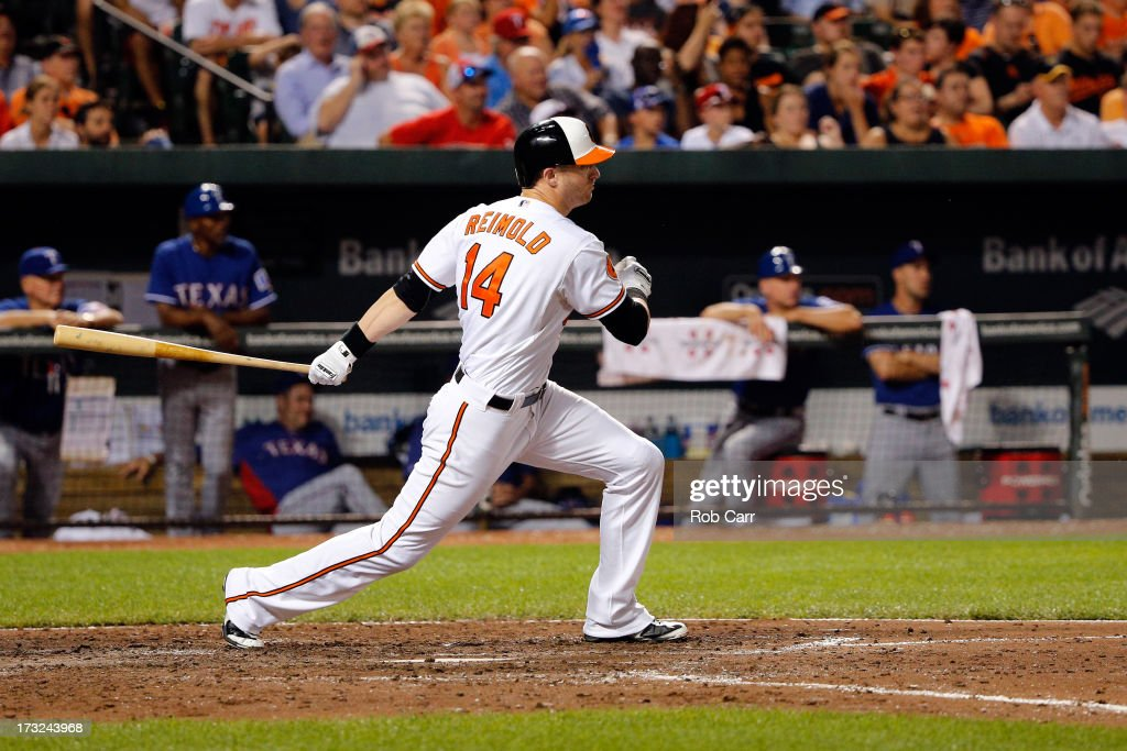 <a gi-track='captionPersonalityLinkClicked' href=/galleries/search?phrase=Nolan+Reimold&family=editorial&specificpeople=757348 ng-click='$event.stopPropagation()'>Nolan Reimold</a> #14 of the Baltimore Orioles follows his single against the Texas Rangers during the sixth inning at Oriole Park at Camden Yards on July 10, 2013 in Baltimore, Maryland.