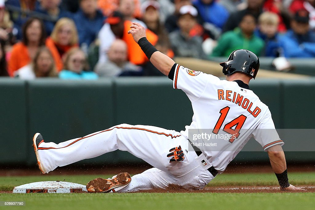 Nolan Reimold #14 of the Baltimore Orioles slides into third base after stealing in the sixth inning against the Chicago White Sox at Oriole Park at Camden Yards on May 1, 2016 in Baltimore, Maryland.