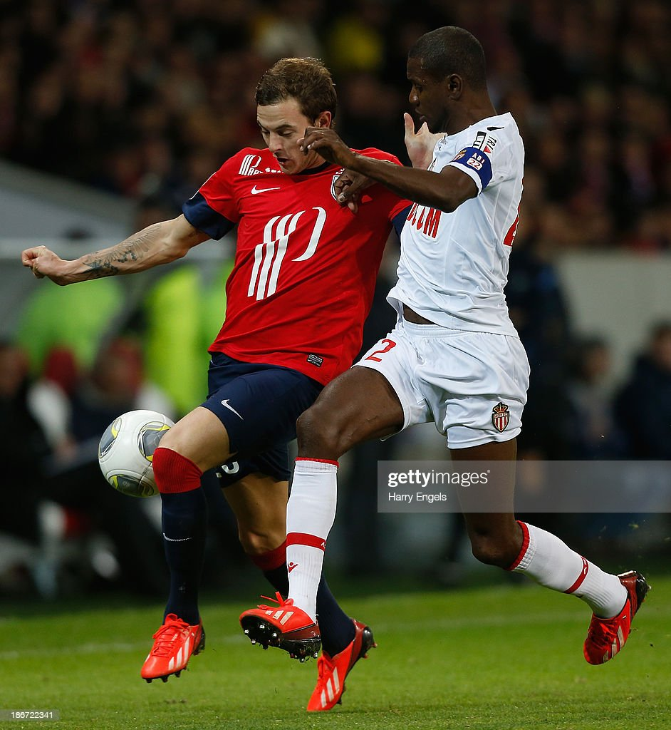 <a gi-track='captionPersonalityLinkClicked' href=/galleries/search?phrase=Nolan+Roux&family=editorial&specificpeople=5969784 ng-click='$event.stopPropagation()'>Nolan Roux</a> of Lille (L) fights for the ball with <a gi-track='captionPersonalityLinkClicked' href=/galleries/search?phrase=Eric+Abidal&family=editorial&specificpeople=469702 ng-click='$event.stopPropagation()'>Eric Abidal</a> of Monaco during the French Ligue 1 match between OSC Lille and AS Monaco at the Grand Stade Metropole Villeneuve-d'Ascq on November 3, 2013 in Lille, France.