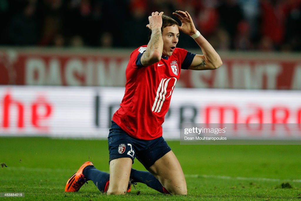 <a gi-track='captionPersonalityLinkClicked' href=/galleries/search?phrase=Nolan+Roux&family=editorial&specificpeople=5969784 ng-click='$event.stopPropagation()'>Nolan Roux</a> of Lille reacts to a referee decision during the Ligue 1 match between LOSC Lille and Olympique de Marseille held at Stade Pierre-Mauroy on December 3, 2013 in Lille, France.