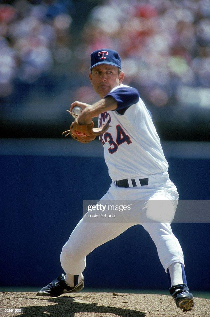 Nolan Ryan of the Texas Rangers pitches during a 1989 MLB game at The Ballpark in Arlington in Arlington Texas