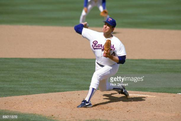 Nolan Ryan of the Texas Rangers pitches during the 1990 season at Arlington Stadium in Arlington Texas
