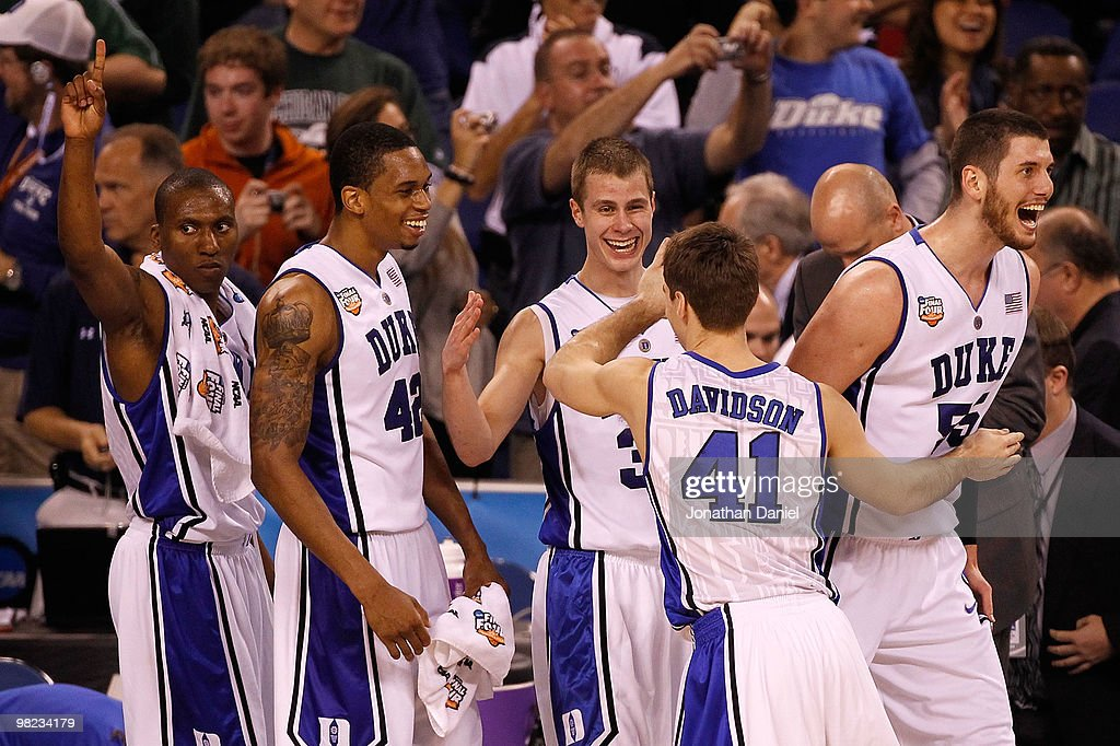Nolan Smith Lance Thomas Jon Scheyer Jordan Davidson and Brian Zoubek of the Duke Blue Devils react late in the second half before the Blue Devils...