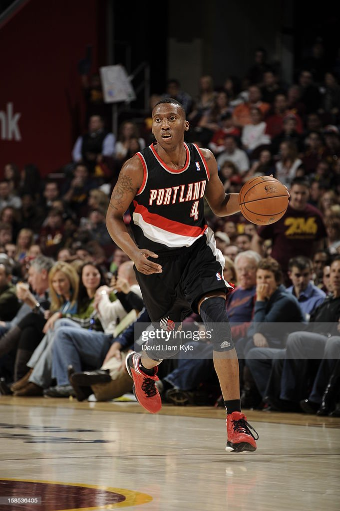 <a gi-track='captionPersonalityLinkClicked' href=/galleries/search?phrase=Nolan+Smith&family=editorial&specificpeople=4215916 ng-click='$event.stopPropagation()'>Nolan Smith</a> #4 of the Portland Trail Blazers brings the ball up court against the Cleveland Cavaliers at The Quicken Loans Arena on December 1, 2012 in Cleveland, Ohio.