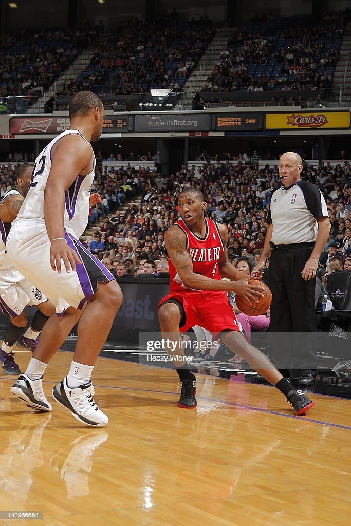 <a gi-track='captionPersonalityLinkClicked' href=/galleries/search?phrase=Nolan+Smith&family=editorial&specificpeople=4215916 ng-click='$event.stopPropagation()'>Nolan Smith</a> #4 of the Portland Trail Blazers dribbles the ball around <a gi-track='captionPersonalityLinkClicked' href=/galleries/search?phrase=Chuck+Hayes&family=editorial&specificpeople=206129 ng-click='$event.stopPropagation()'>Chuck Hayes</a> #42 of the Sacramento Kings on April 15, 2012 at Power Balance Pavilion in Sacramento, California.