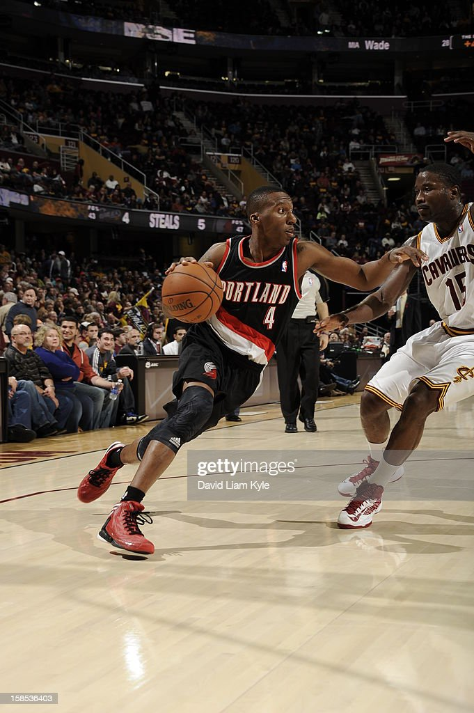 <a gi-track='captionPersonalityLinkClicked' href=/galleries/search?phrase=Nolan+Smith&family=editorial&specificpeople=4215916 ng-click='$event.stopPropagation()'>Nolan Smith</a> #4 of the Portland Trail Blazers drives to the basket around <a gi-track='captionPersonalityLinkClicked' href=/galleries/search?phrase=Donald+Sloan&family=editorial&specificpeople=4185817 ng-click='$event.stopPropagation()'>Donald Sloan</a> #15 of the Cleveland Cavaliers at The Quicken Loans Arena on December 1, 2012 in Cleveland, Ohio.