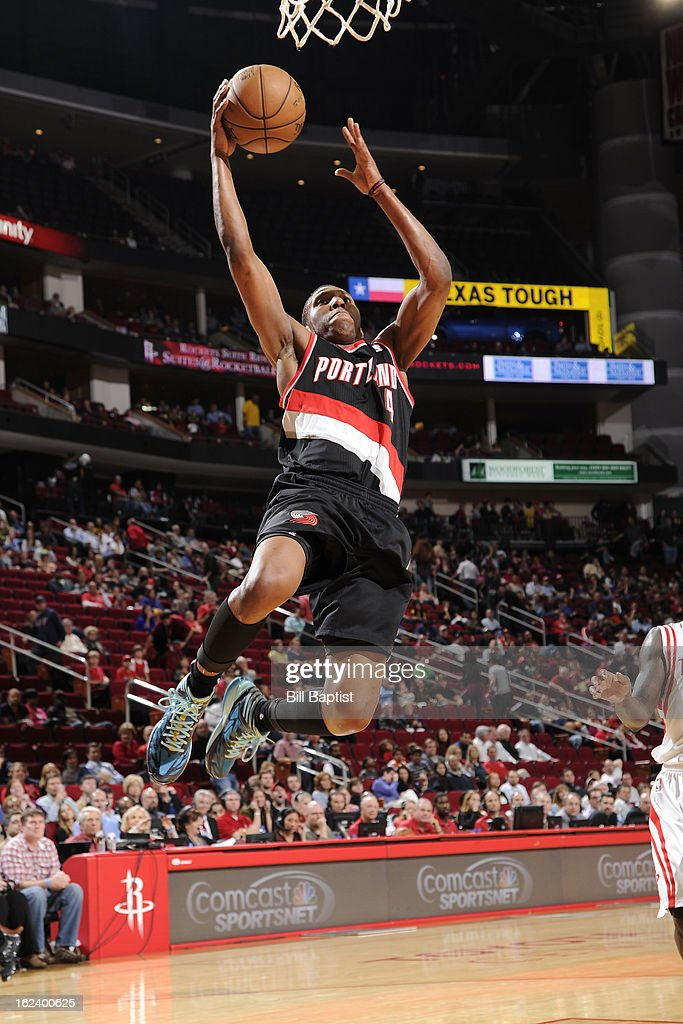 <a gi-track='captionPersonalityLinkClicked' href=/galleries/search?phrase=Nolan+Smith&family=editorial&specificpeople=4215916 ng-click='$event.stopPropagation()'>Nolan Smith</a> #4 of the Portland Trail Blazers glides to the rim against the Houston Rockets on February 8, 2013 at the Toyota Center in Houston, Texas.