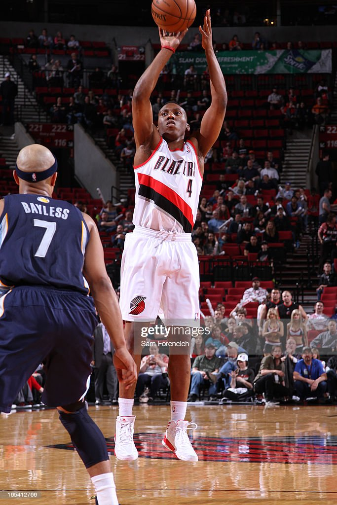 <a gi-track='captionPersonalityLinkClicked' href=/galleries/search?phrase=Nolan+Smith&family=editorial&specificpeople=4215916 ng-click='$event.stopPropagation()'>Nolan Smith</a> #4 of the Portland Trail Blazers goes for a jump shot during the game between the Memphis Grizzlies and the Portland Trail Blazers on April 3, 2013 at the Rose Garden Arena in Portland, Oregon.