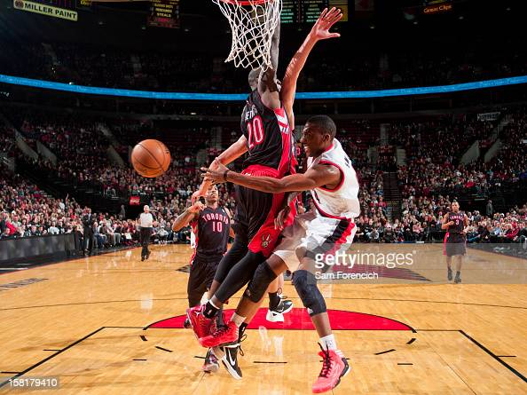 Nolan Smith of the Portland Trail Blazers passes the ball in the lane against Mickael Pietrus of the Toronto Raptors on December 10 2012 at the Rose...