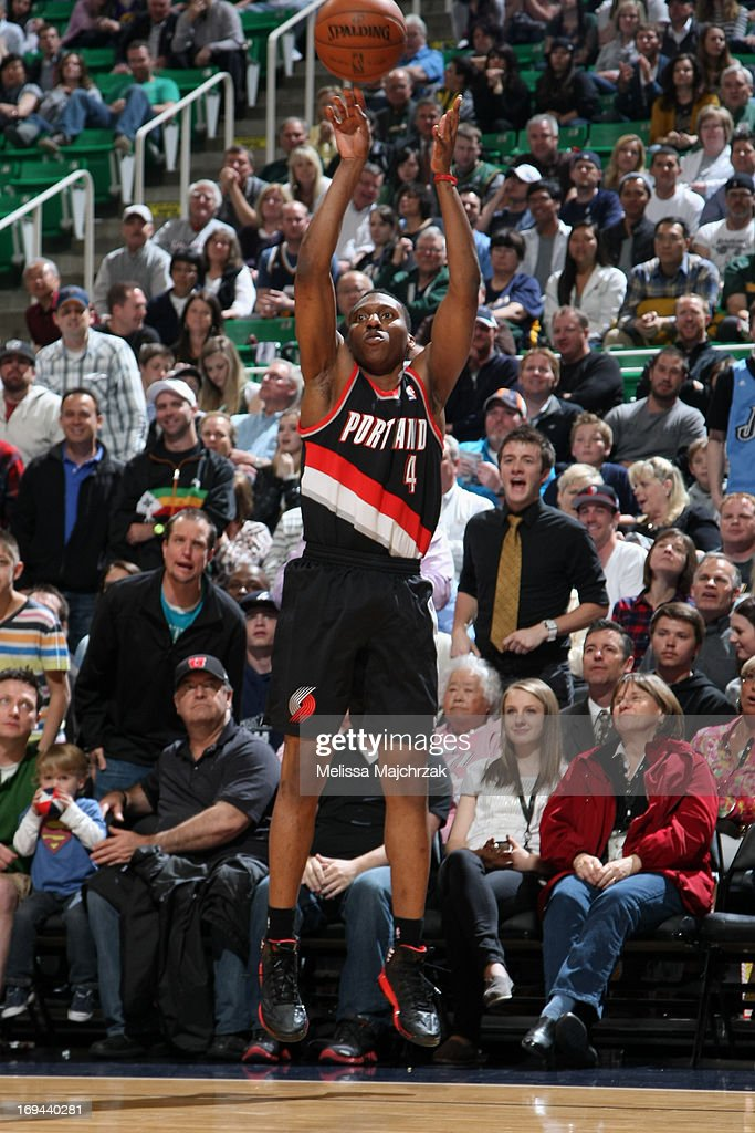 <a gi-track='captionPersonalityLinkClicked' href=/galleries/search?phrase=Nolan+Smith&family=editorial&specificpeople=4215916 ng-click='$event.stopPropagation()'>Nolan Smith</a> #4 of the Portland Trail Blazers shoots a three pointer during the game against the Utah Jazz at Energy Solutions Arena on April 1, 2013 in Salt Lake City, Utah.