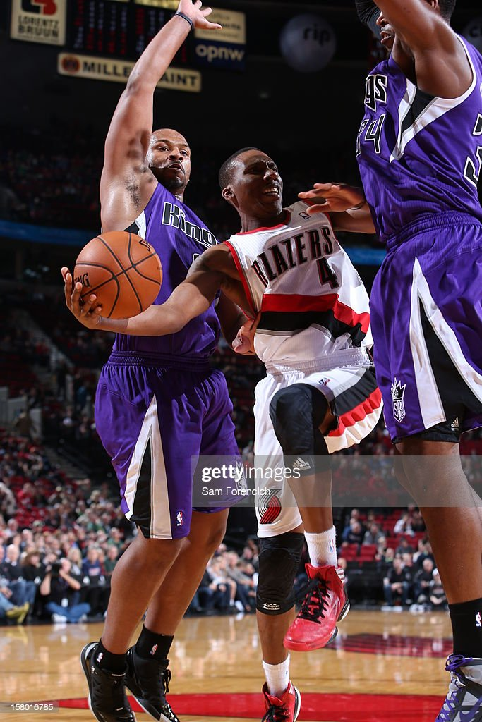 Nolan Smith #4 of the Portland Trail Blazers splits defense during the game between the Sacramento Kings and the Portland Trail Blazers on December 8, 2012 at the Rose Garden Arena in Portland, Oregon.