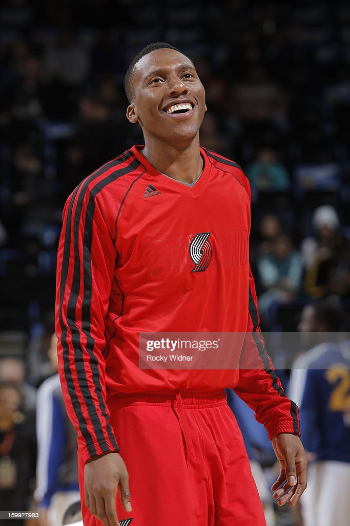 <a gi-track='captionPersonalityLinkClicked' href=/galleries/search?phrase=Nolan+Smith&family=editorial&specificpeople=4215916 ng-click='$event.stopPropagation()'>Nolan Smith</a> #4 of the Portland Trail Blazers warms up before a game against the Golden State Warriors on January 11, 2013 at Oracle Arena in Oakland, California.