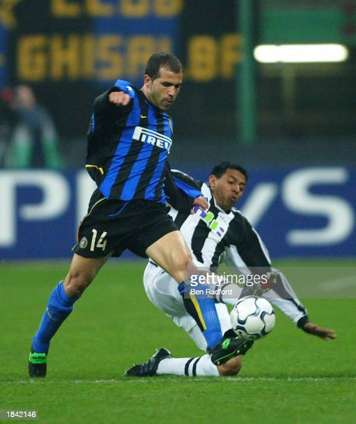 Nolberto Solano of Newcastle United battles with Luigi Di Biagio of Inter Milan during the Champions League match between Inter Milan and Newcastle...