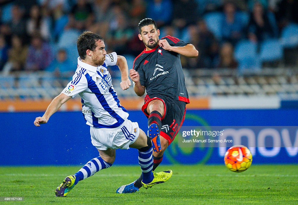 Nolito of Celta de Vigo duels for the ball with Mikel Gonzalez of Real Sociedad during the La Liga match between Real Sociedad de Futbol and Celta de...