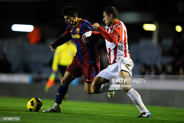 Nolito of FC Barcelona B duels for the ball against Migue of Girona during the La Liga Adelante match between FC Barcelona B and Girona at Mini...