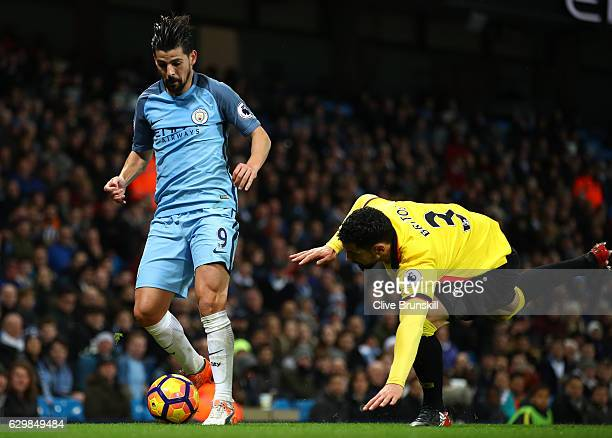 Nolito of Manchester City and Miguel Britos of Watford compete for the ball during the Premier League match between Manchester City and Watford at...