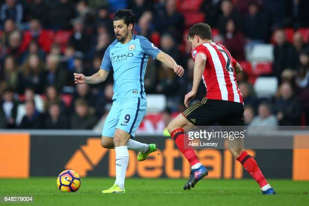 Nolito of Manchester City attempts to get past Billy Jones of Sunderland during the Premier League match between Sunderland and Manchester City at...